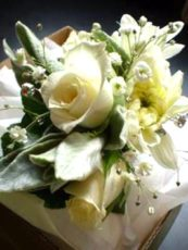 Wrist-Corsage-with-White-Roses-and-Soft-Grey-Lambs-Ear-Foliage-image1