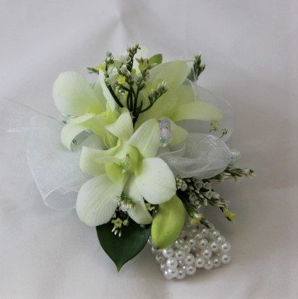Wrist corsage with creamy white Singapore Orchids