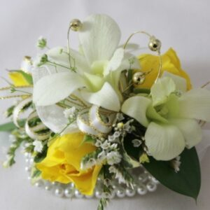 Corsage with Yellow Roses and white mini orchids