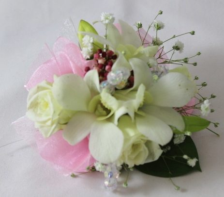 Corsage with white roses and mini orchids pink ribbon detail delicate gypsophila