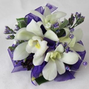 Purples and whites wrist corsage for the ball